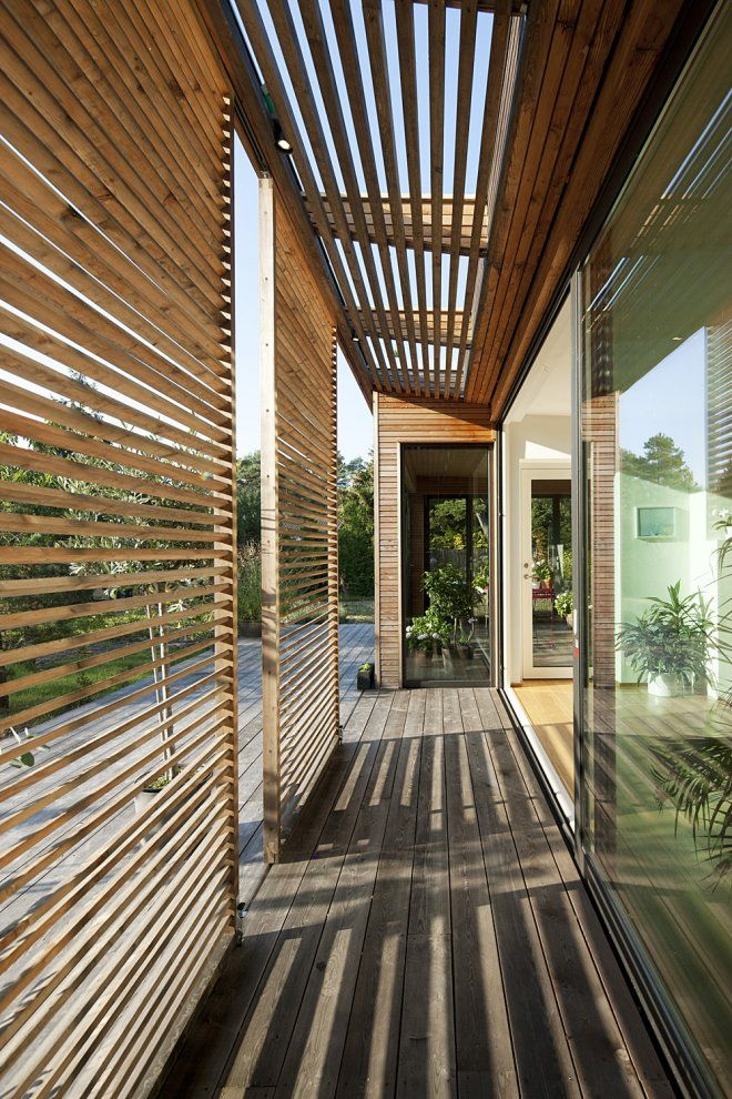 Outdoor rooms are the latest craze, what about outdoor hallways. Great idea and provides shade to house.