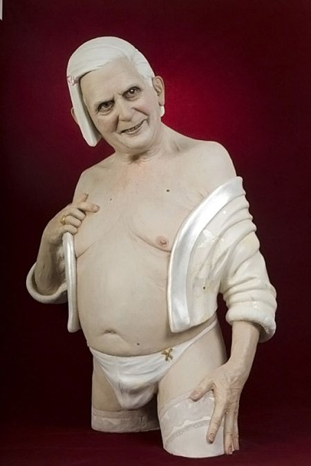 """The sculpture, titled """"Miss Kitty"""" by Paolo Schmidlin, portrays the Pope wearing nothing but thigh-high stockings, a pair of panties and a stole. The sculpture, which is adorned with a blonde bob wig, offended the Catholic Anti-Defamation League, which threatened to seek charges against the organizers and exhibit promoters for defaming a head of state."""
