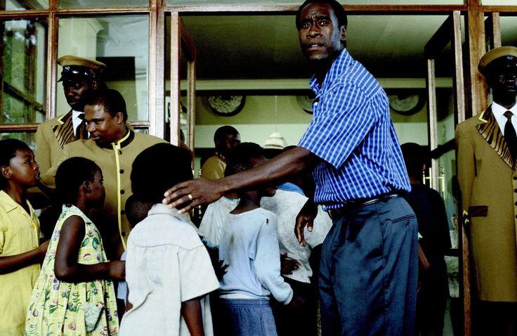 """Hotel Rwanda"" movie still, 2004.  Don Cheadle as Paul Rusesabagina."