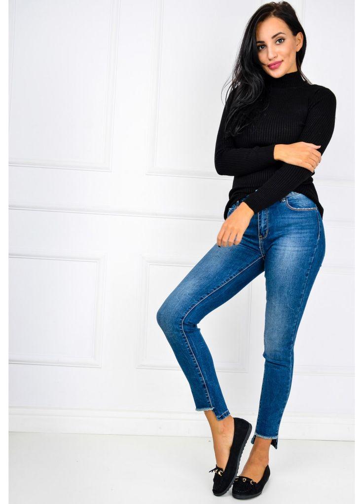 Spodnie jeans z rozjaśnieniami i poszarpanymi nogawkami