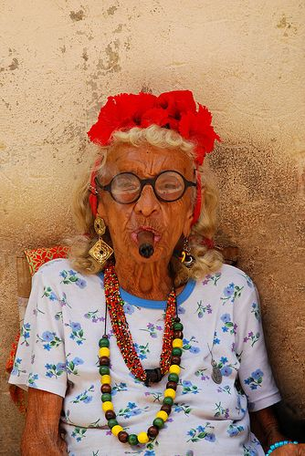 Vivrant. Smokin' Graciela - Havanna's famous cigar lady can be found on the streets with a cigar in her mouth, letting tourists take photos of her for a few pesos.