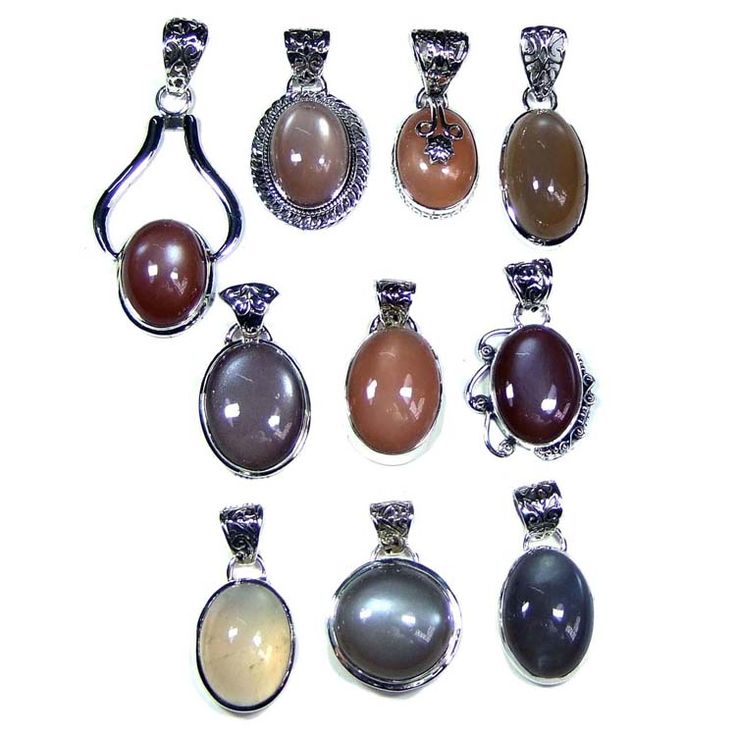 Silver Jewelry Pendants Lot With Cats Eye Gemstones  Price $USD   225   Weight 250 gms