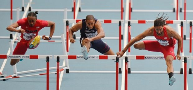From left, United States' Aries Merritt, France's Thomas Martinot-Lagarde and United States' Jason Richardson compete in a men's 110-meter hurdles semifinal at the World Athletics Championships in the Luzhniki stadium in Moscow, Russia - by Martin Meissner, German