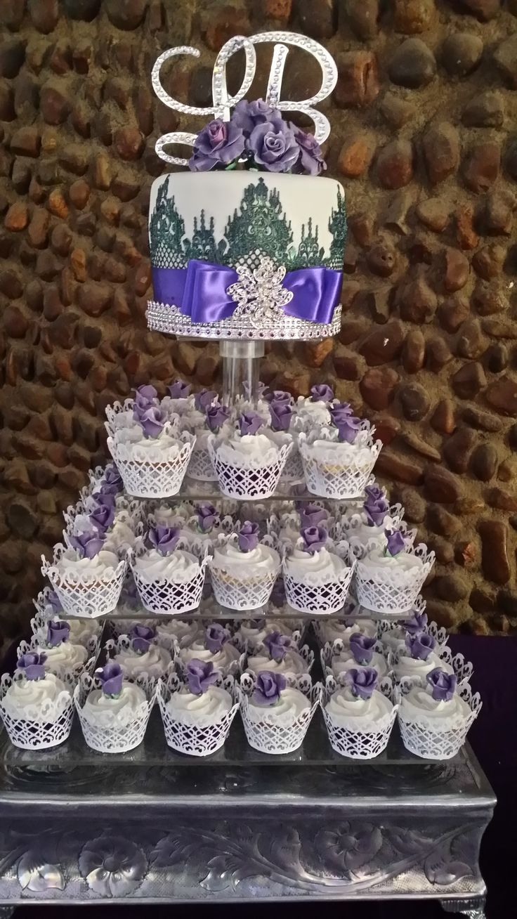 Purple, black and white, cupcake wedding cake, with lots of Bling. www.helens-cake-craft.co.za