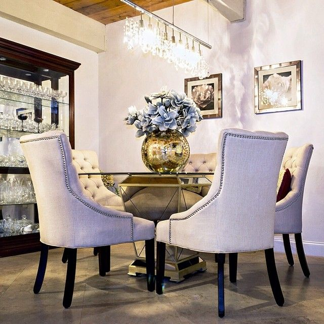 Features Our Marseilles Dining Chairs Borghese Round Table Linear Strand Crystal Chandelier
