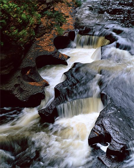 The Presque Isle River cascades through Michigan's Porcupine Mountains and the Ottawa National Forest before emptying into Lake Superior.