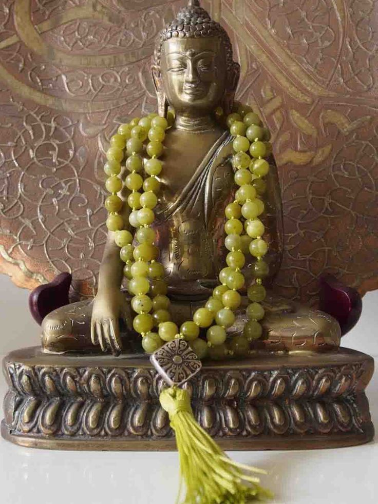 Sally McBride PERIDOT Mala comprised of 108 beads 8 mm diameter round with a silver guru bead and tassel.