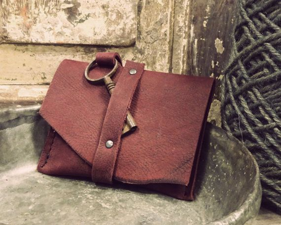 Red handmade wallet with antique key.