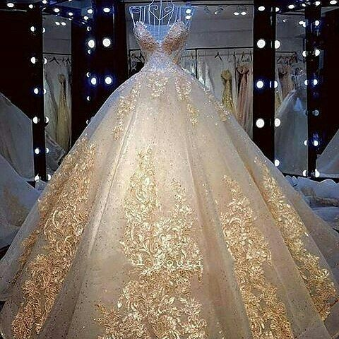 Here is a ball gown princess style wedding dress with gold embroidery and embellishments.  Custom #weddingdresses is what wee do.  We are in the USa and also offer #replicas of couture designer ball gowns for brides who cant afford the original.  Email us for pricing and more details.  DariusCordell.com