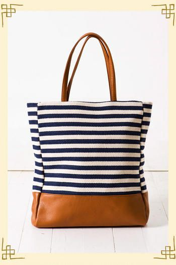 This bag is perfect for summer! The navy and white stripes give a nautical feel to it! And I just love the brown straps and bottom!