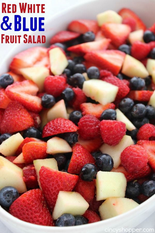 Red White and Blue Fruit Salad- Perfect for July 4th! Red strawberries, red raspberries, and white apples all mixed with a yummy lime dressing.