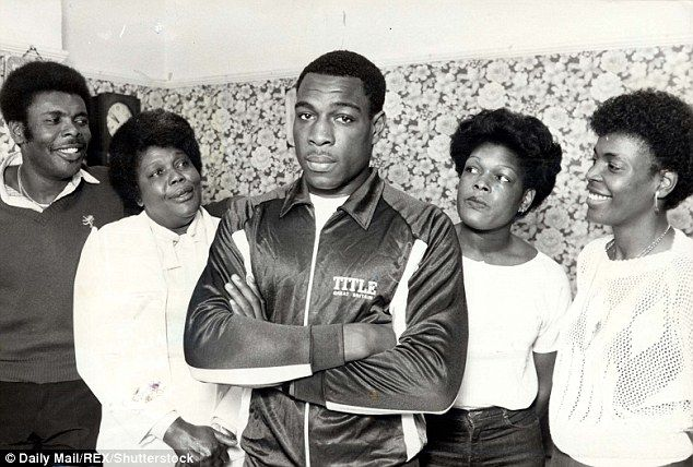 Boxer Frank Bruno with his family including (l-r) brother Michael, mother Lynette, sisters Joan and Fay at home in Wandsworth south London