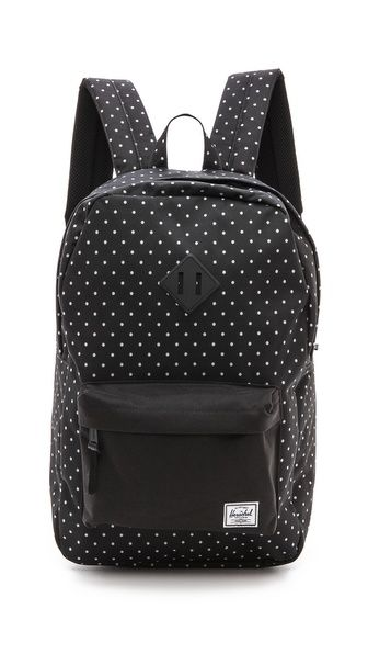 Herschel Supply Co. backpack with a polka-dotted nylon shell and reinforced bottom panel.