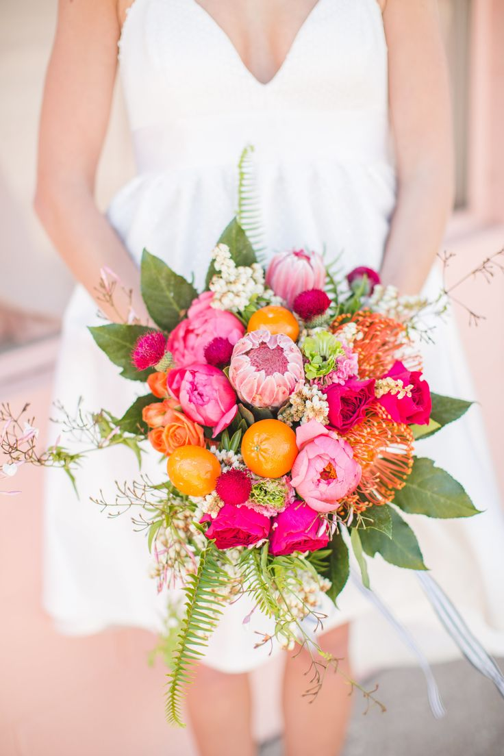 Pink and orange bridal bouquet. Photography: Aly Carroll - alycarroll.com  Read More: http://www.stylemepretty.com/2014/09/09/modern-and-preppy-elopement-shoot/