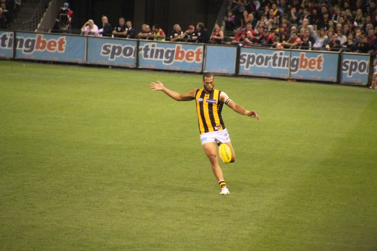 Josh Gibson kicking the Sherrin