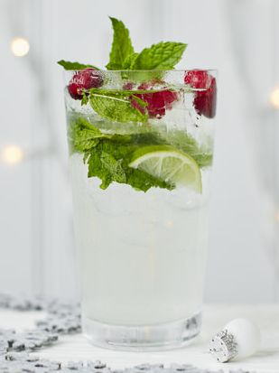 Give this classic cocktail a festive makeover with ruby red cranberries and tropical coconut water, alongside the usual glug of rum, spoons of sugar and squeeze of lime. | Tesco