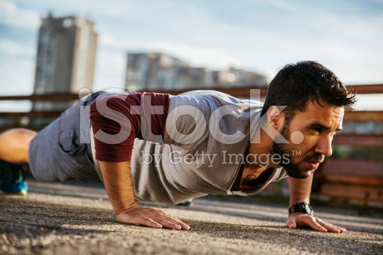 Photo of a young athletic man exercising outdoors royalty-free stock photo