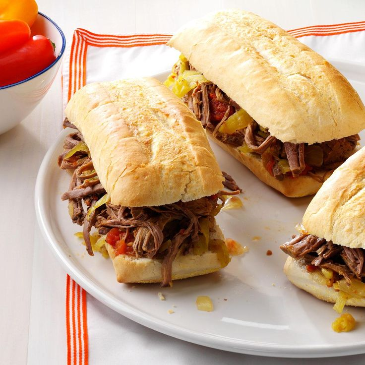 Family-Favorite Italian Beef Sandwiches Recipe -With only a few ingredients, this roast beef is a snap to throw together. And after cooking all day, the meat is just so tender. —Lauren Adamson, Layton, Utah