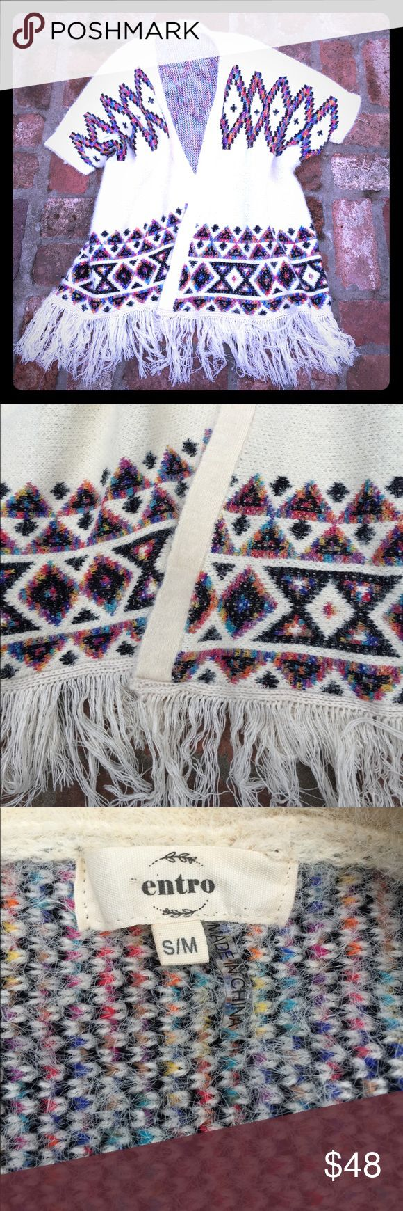 ENTRO COZY SHRUG TRIBAL PRINT🌟🌟 50/50 acrylic/polyester blend shrug with beautiful colors!  Tribal print on winter white!  No issues, gently worn entro Sweaters Shrugs & Ponchos