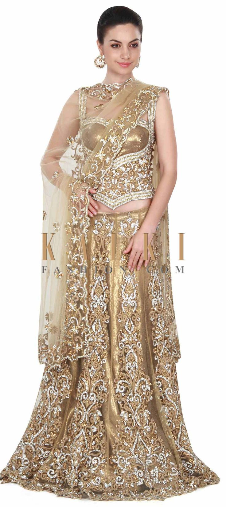 Buy this Gold lehenga adorn in kundan and stone embroidery only on Kalki