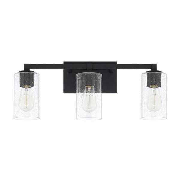 Consider all the options! This timeless 3-Light Vanity Light with Clear Seeded Glass fixture can be mounted with the seeded glass shades facing up or down. And the choice of bulbs can completely change the look. Flickering flame bulbs soften the style for rustic romance, while tapered or tubular bulbs offer a more modern, industrial look. The clean lines and rich black iron finish make it an ideal choice for a variety of decors.