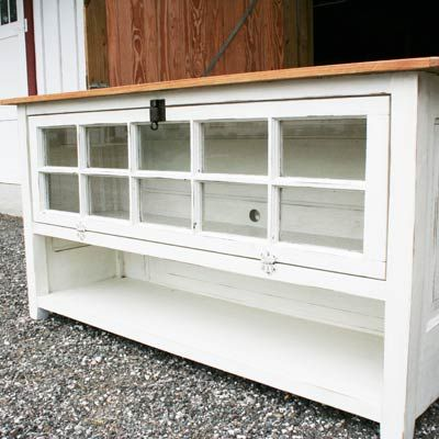 """My dad and I build furniture from antique salvaged items. We build furniture with all kinds of things from old doors, windows, salvaged wood, and repurposed furniture pieces. We built the sides and back of this TV console from an old door. The front is a old casement window, and the top is old heart pine."""""""