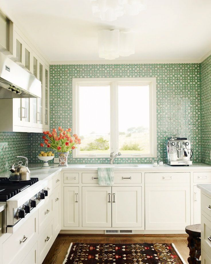 Green tiled backsplash in white kitchen