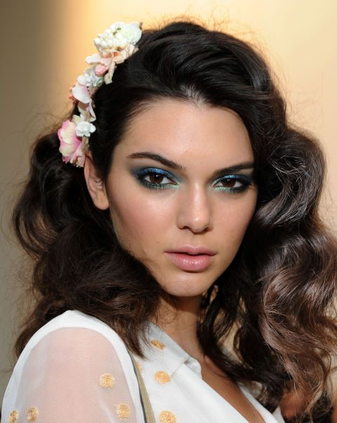Models including Kendall Jenner (pictured) rocked 'The Diane' 'do, inspired by how the designer herself wore her curly hair in the 70s. Hairstylist Orlando Pita was behind the look, creating rows of buns in the models' hair to form curls when unraveled (get the how-to here!). To complete the Studio 54-inspired look, renowned makeup artist Pat MgGrath applied aquamarine eye shadow around the eyelids; upper and lower lash lines, then plenty of black mascara.