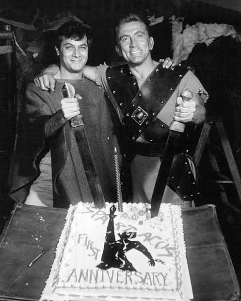 """Tony Curtis (1925-2010) and Kirk Douglas (b. 1916) celebrate the end of one year's shooting of """"Spartacus"""", released in 1960"""