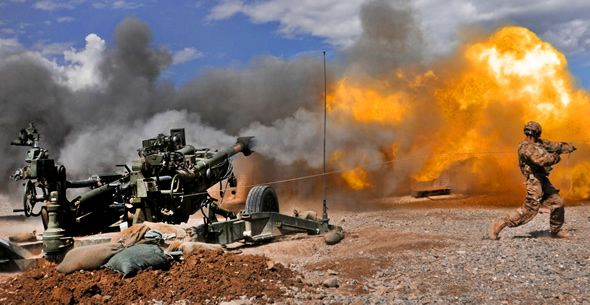 An M-777 155mm howitzer fires at a low ballistic trajectory in Afghanistan…