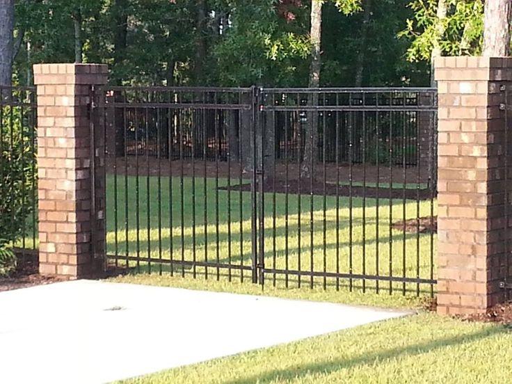 Steel Gate Between Brick Columns Elite Fencing Elite Fencing In Lexington Sc Quot Your Neighbors Stand Behind Our Fences Quot Pinterest Bricks