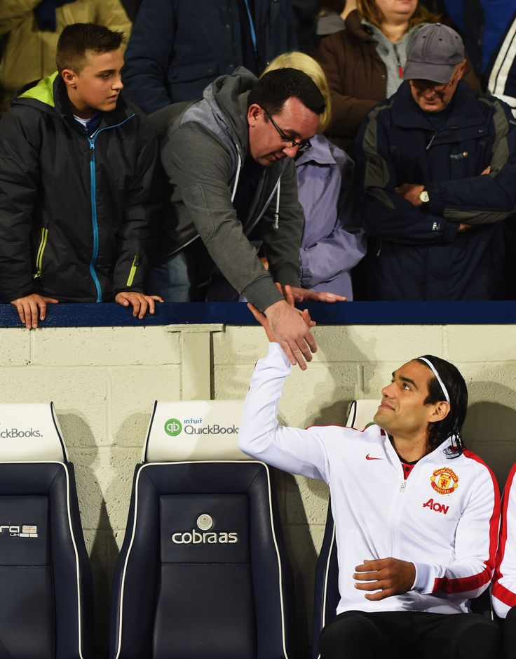 @manutd's Colombian forward Radamel Falcao greets a fan before the Reds' away match against West Brom at The Hawthorns.