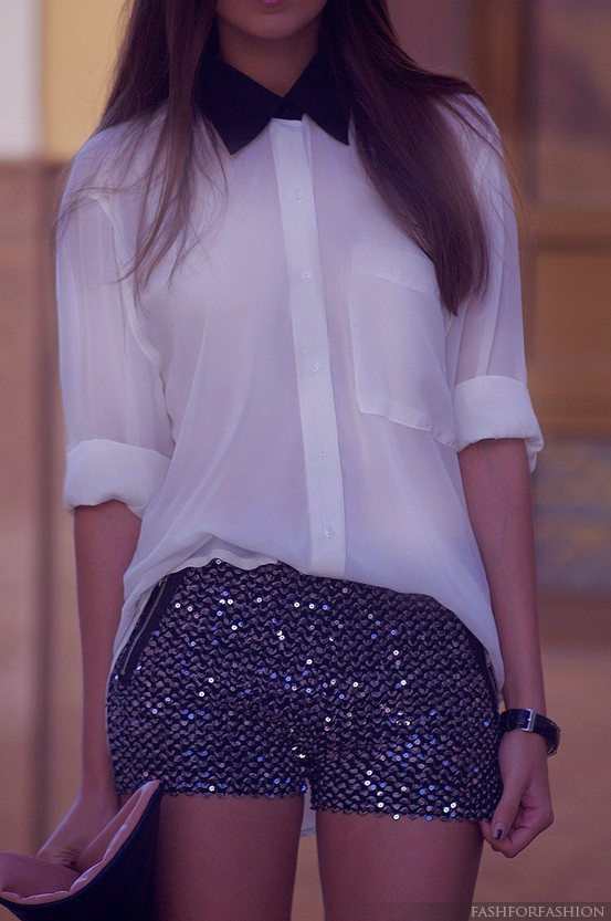 sheer blouse and sparkly shorts