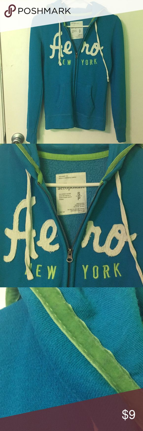 Women's Aero Hoodie Women's hoodie. Worn a few times and in good condition. Colors: Blue, white writing, green outlining. Size: Small Aeropostale Tops Sweatshirts & Hoodies