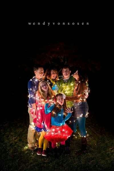 Christmas family pic - clear lights, colorful wardrobe, outdoors, at night