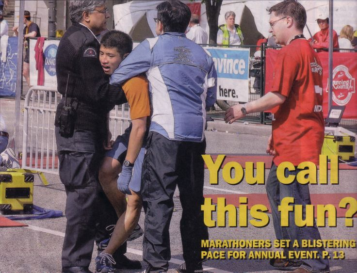 One of our volunteers comforting a marathon runner.