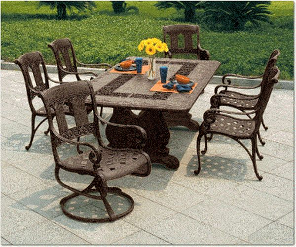 outdoor brown stained steel dining set with yellow flower also transparant vase and blue glass - Cheap Patio Sets