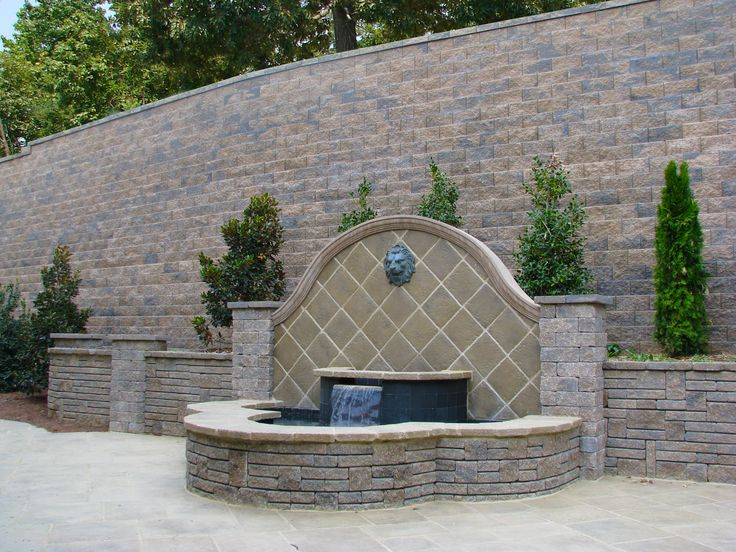Water feature built in front of retaining wall