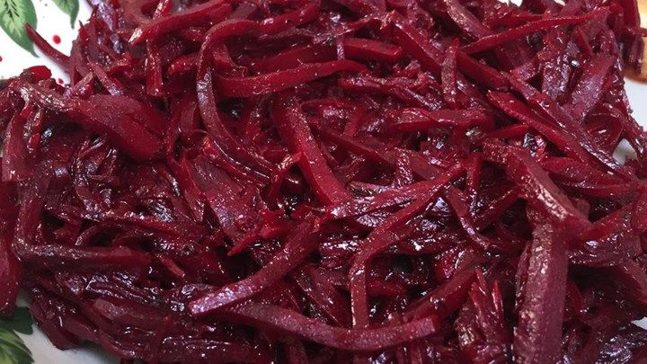 This raw beet salad is a combination of shredded beets tossed with garlic, balsamic vinegar, and olive oil for a refreshing and colorful lunch.