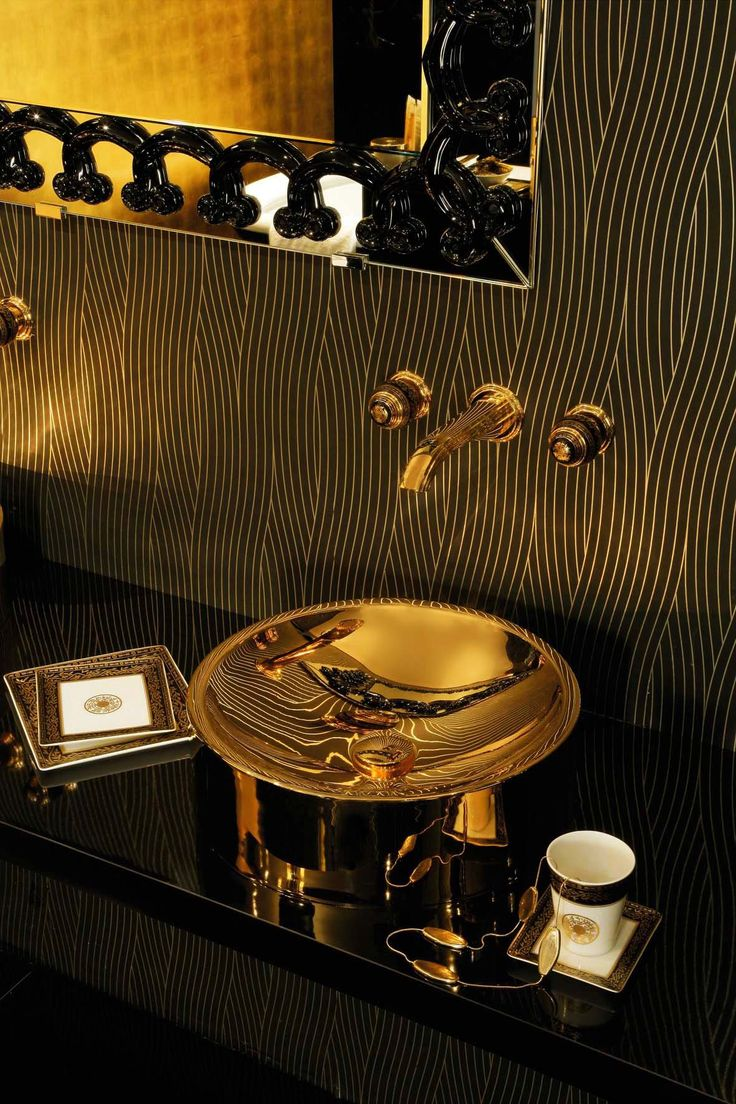 Luxury black and gold bathroom | The bathroom is in the Art Deco style influenced patterns of French palaces, the laurel wreath in gold | #luxurybathrooms #bathroomdesign #bathroomdecor
