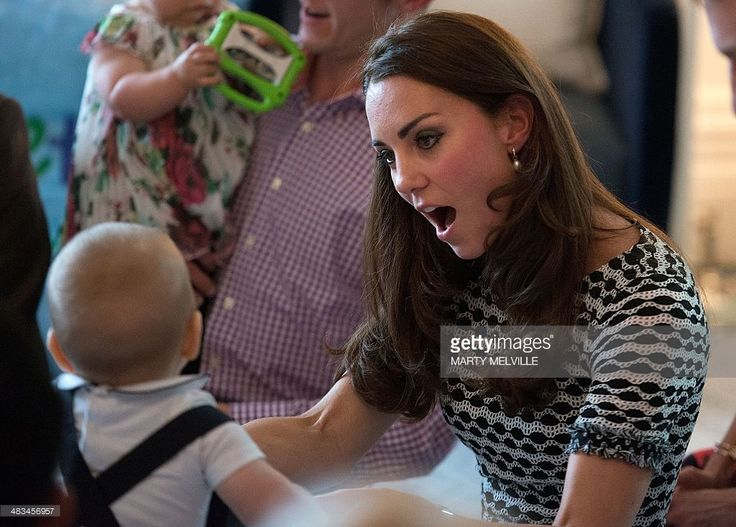 Catherine (R), the Duchess of Cambridge, plays with Prince George during a Plunket nurse and parents group visit at Government House in Wellington on April 9, 2014. Plunket is a national not-for-profit organisation that provides care for children and families in New Zealand. Britain's Prince William, Kate and their son Prince George are on a three-week tour of New Zealand and Australia.    AFP PHOTO / POOL / MARTY MELVILLE        (Photo credit should read Marty Melville/AFP/Getty Images)