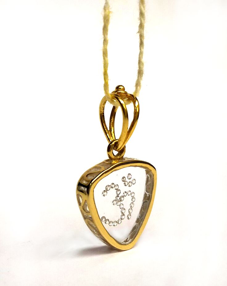 14 Kt Gold With Real Diamond Jewellery.Specialy In Giftting Purpose.Daimond Setting In Glass. Product Size(0.90 x 0.50 Inches) Gold Wieght Approx 1.90 Gm.Diamond Wieght 0.15 ct.