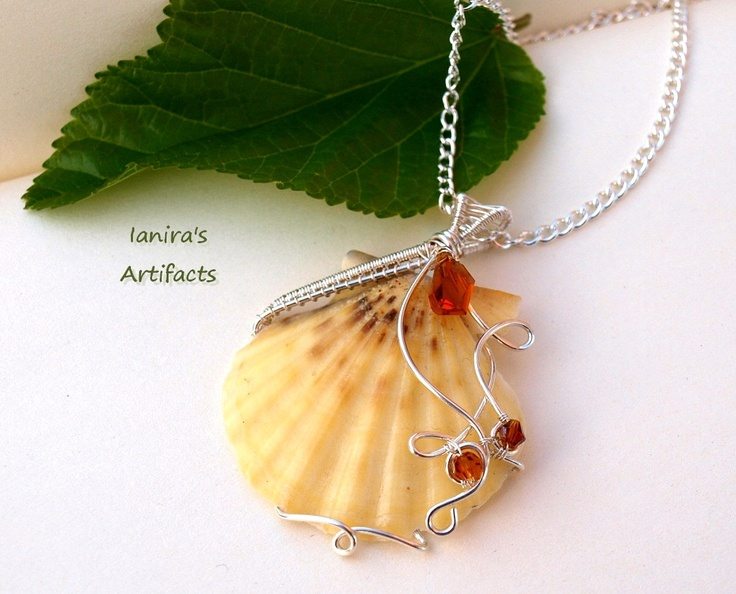 OOAK Silver plated Wire wrapped shell pendant. €16,00, via Etsy. Love that this has color and the swirls aren't swirls or bends