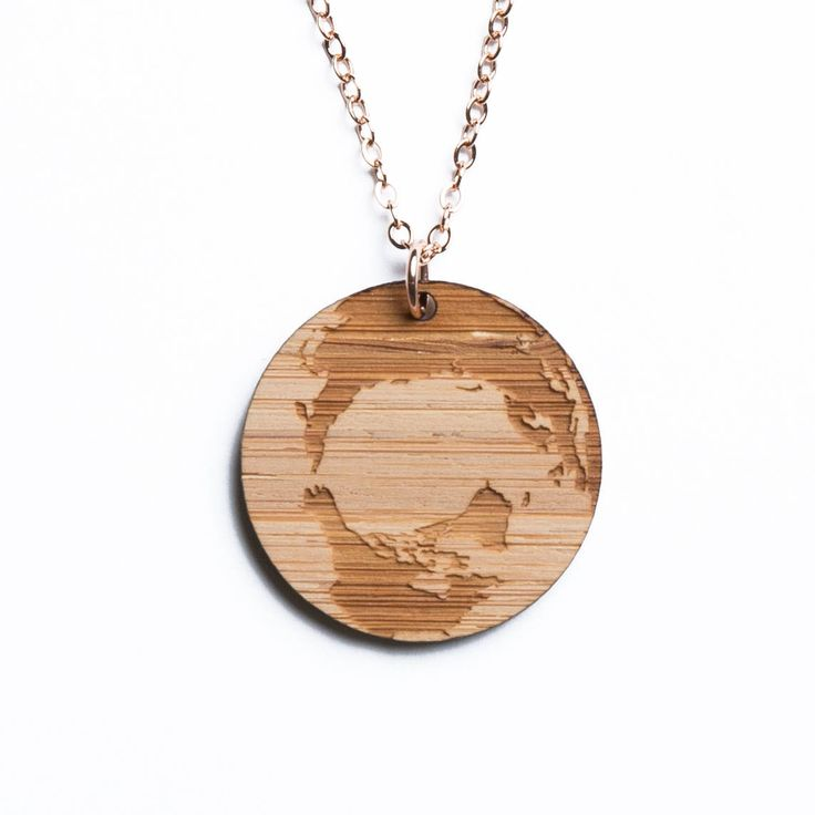 Arctic map necklace (with Canada, Greenland, and Russia), etched into eco-friendly FSC certified bamboo (using a laser burner), on a recycled rose gold plated sterling silver chain.