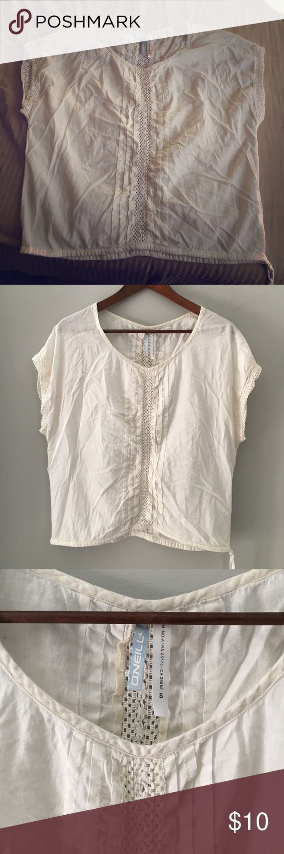 Cream short sleeve top Cream cotton top with decorative sleeves. Barely worn with no wear. Very comfortable!!!! Must have! O'Neill Tops Tunics