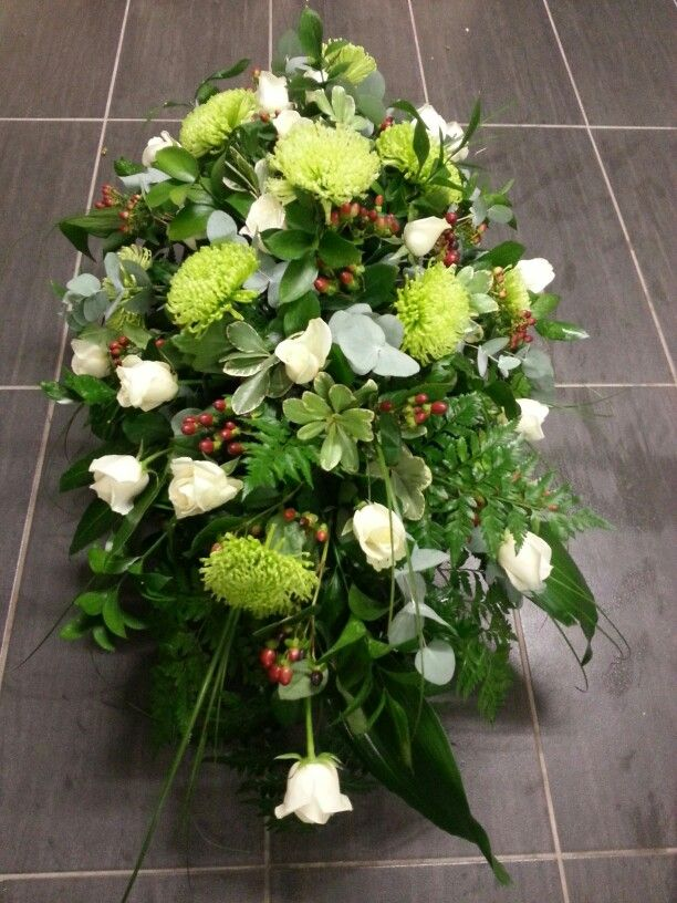 Coffin spray with Anastasia Chrysanthemum blooms, Avalanche Roses, Hypericum berries, mixed foliages. Lovely, simple and classy tribute.