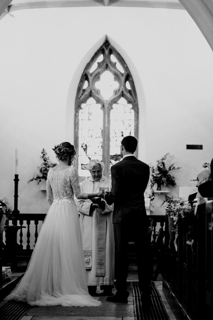 We love photographing down the aisle as well as from the front if we can - it helps give a beautiful perspective of what the guests see but also the feeling of it just being about the couple themselves. Photo by Benjamin Stuart Photography #weddingphotography #blackandwhite #brideandgroom #gettingmarried #weddingday #church