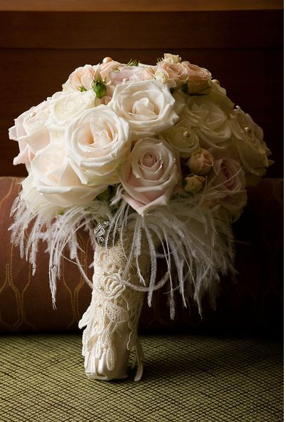this romantic, vintage styled bouquet is simple perfect with it feather and lace accents