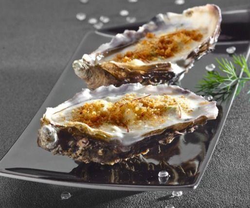 """750g vous propose la recette """"Huitres à la crème d'asperge et safran, gratinées au roquefort"""" notée 4.5/5 par 24 votants."""