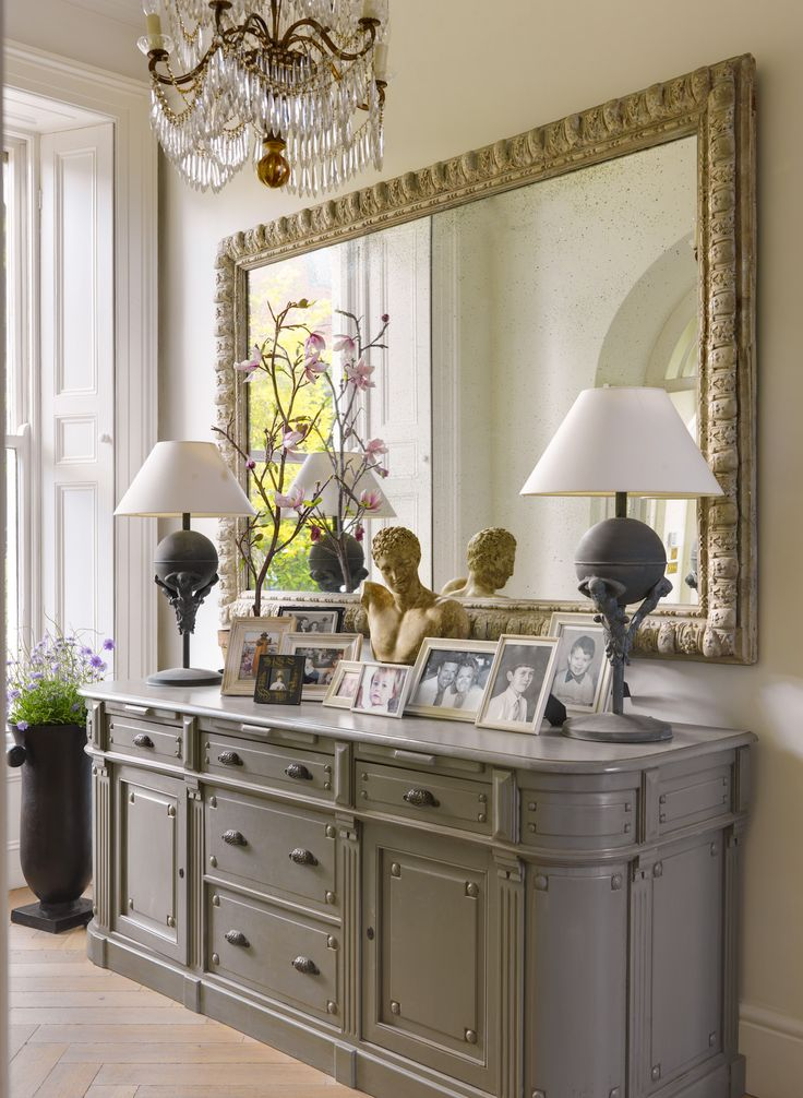 Two Crystal Candelabra With Gold Curly Willow In Front Of Mirror   Entrance  Hall With Sideboard And Large Mirror